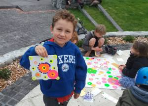 Proud young artist showing his publicly created artwork at Featherston, NZ First Friday December 2016