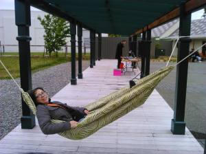 Woman in a hammock at December 2016 First Friday in Featherston NZ, in the Featherston Town Square