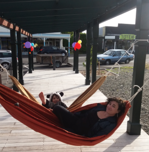 two cool people in colourful hammocks