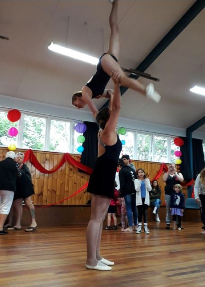 Sophia Therese and Ry, acrobats